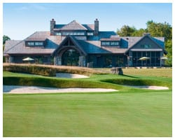 Golf clubhouse with sand traps and green grass in foreground