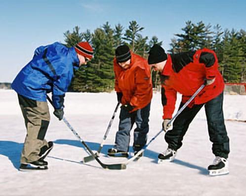 Three people playing ice hockey